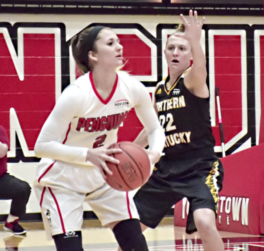 Tribune Chronicle / John Vargo Allison Smolinski, left, of Youngstown State, looks to make a pass as Kelley Wiegman of Northern Kentucky defends.