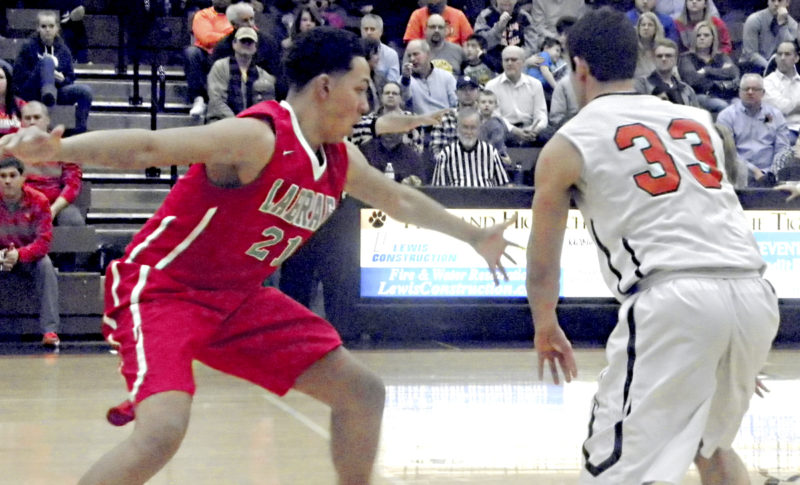 Tribune Chronicle / Eric Murray LaBrae's Tyler Stephens, left, guards Howland's Kevin Moamis during Friday's game in Howland. The Vikings handled the Tigers, 77-60.