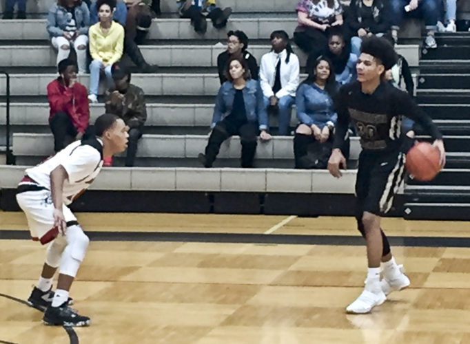 Tribune Chronicle / Joe Simon Warren G. Harding's Mike Hughes dribbles up court against Canton McKinley's Sam Williams in the Bulldogs' 70-61 victory over Harding on Friday night. The loss snapped the Raiders' 10-game winning streak.