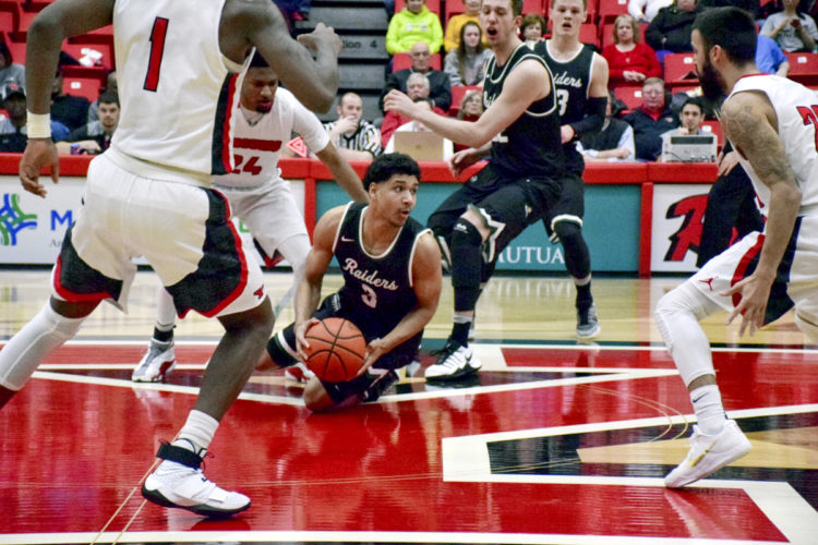 Tribune Chronicle / John Vargo Ursuline graduate Mark Hughes, center, corrals a loose ball prior to it going past midcourt Thursday against Youngstown State. Hughes plays for Wright State.