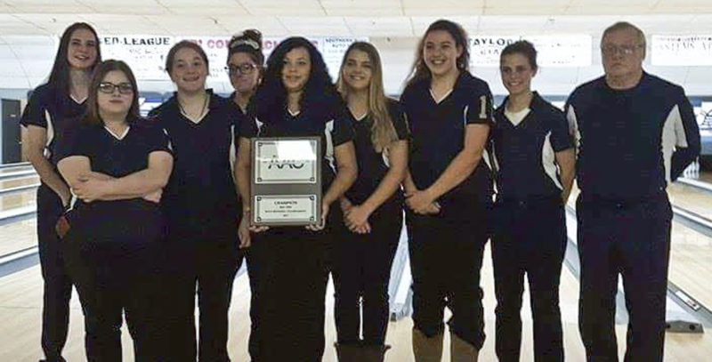 Special to Tribune Chronicle Members of the Warren G. Harding girls bowling team include, from left, Taylor Arquette, Elizabeth Jones, Brianna Nolen, Isabella Frazzini, Emily Oswald, Zoey Schoolcraft, Payton Schuller, Katelyn Daughtery and coach John Nolen. The Raiders won the Division I sectional title on Sunday, then followed up by winning the All-American Conference Red Tier tournament on Monday.