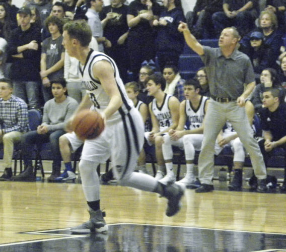 Tribune Chronicle file / Eric Murray McDonald coach Jeff Rasile, right, shouts out directions as the Blue Devils' Evan Magill dribbles during a game earlier  this season. McDonald and LaBrae both finished ranked No. 1 in the final Associated Press state poll.