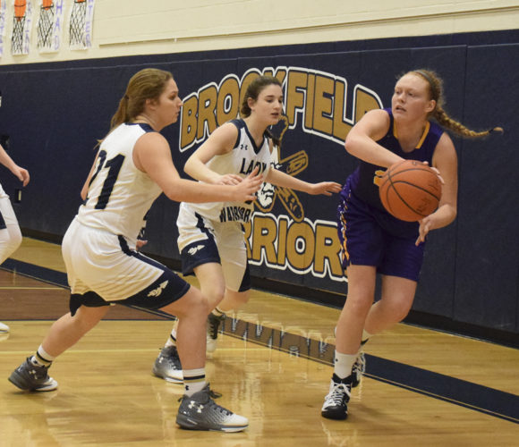 Tribune Chronicle / John Vargo Brookfield's Lauren Pesa, left, and Chloe Willrich, center, apply pressure against Berkshire's JoAnne Miller on Wednesday in Brookfield. The Warriors won this Division III sectional first-round game, 59-29.