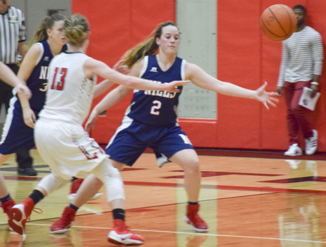 Tribune Chronicle / Eric Murray Amanda Blank (2) of Niles defenses a pass by Alexis Bury of Struthers Thursday night in their Division II sectional bracket final at Struthers. The Wildcats beat the Red Dragons for the third time this season, 55-29.