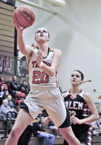 Tribune Chronicle / Bob Ettinger Howland's Sara Price flies to the hoop during the Tigers' 51-37 win over Salem Thursday on the Tigers' floor. The victory sends Howland to the Division II district next week at Austintown Fitch.