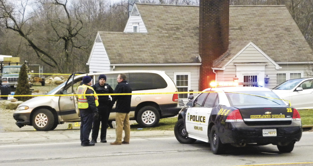 Law enforcement stand next to a vehicle that victims were shot in at a home located along Niles-Cortland Rd (Rt. 46)in Howland late Saturday afternoon...by Emily Earnhart