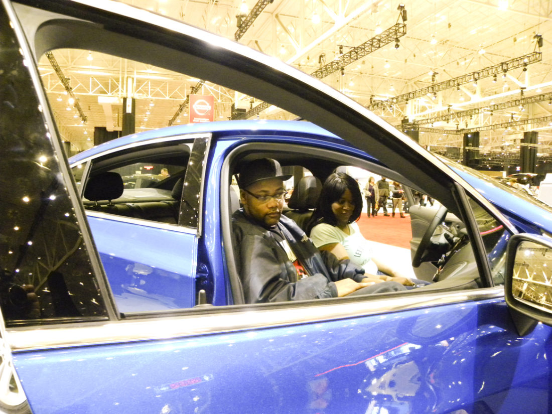 Rocky and Tawana Warren of Youngstown examine a Lordstown-made Chevrolet Cruze at the Cleveland Auto Show.