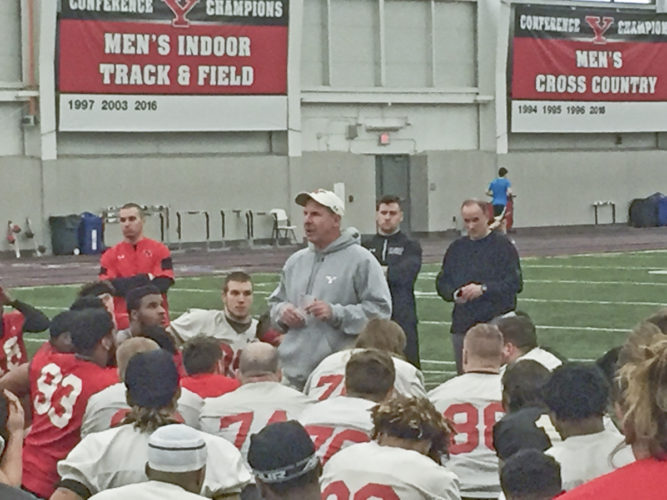 Tribune Chronicle / Joe Simon Coach Bo Pelini addresses the Youngstown State football team Monday on the first day of spring practice.