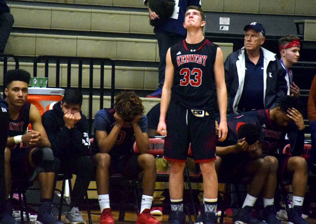 Tribune Chronicle / John Vargo JFK's Justin Bofenkamp looks up after the Eagles' 67-64 loss to Lutheran East in a Division IVregional final in Canton on Friday.