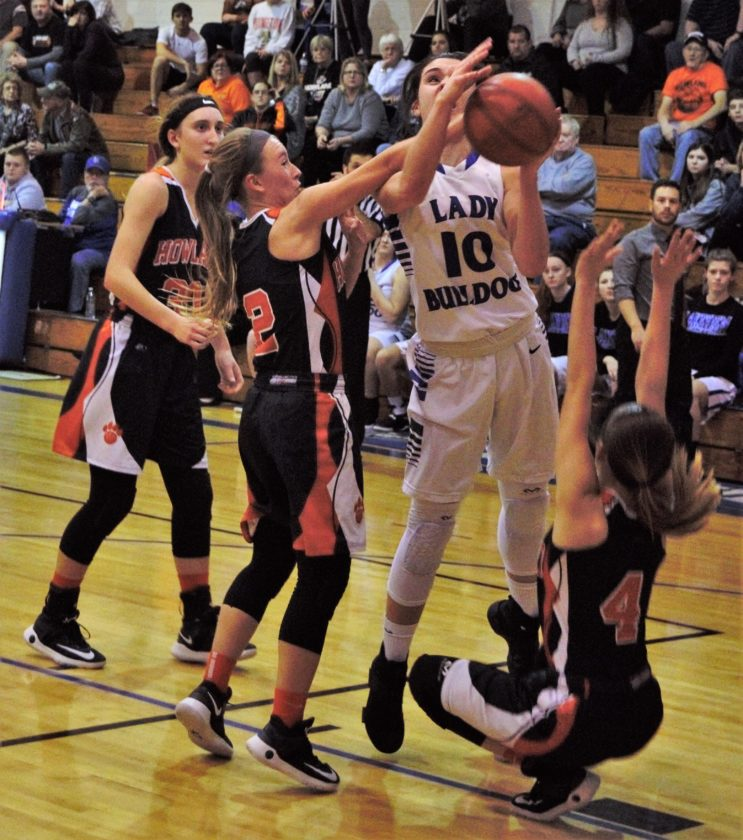 Tribune Chronicle / Bob Ettinger Lakeview's Annie Pavlansky (10) drives against Howland's Izzy Albrecht (2) and Mackenzie Maze (4) earlier this season. Pavlansky made a verbal commitment to Kent State University. She can officially sign in mid-November.