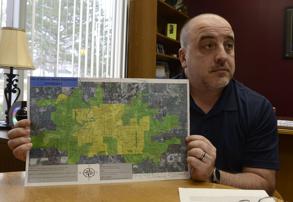 031717...R WAR  LEAD PIPES 2...Warren...03-17-17... Franco Lucarelli. Director, Warren Utility Services, holds a colored coded map of Warren, green and yellow, that have the probability of lead water pipes...by R. Michael Semple