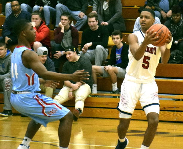 Tribune Chronicle fil / Eric Murray John F. Kennedy junior Byron Taylor (5), shown in an earlier game against Cleveland VASJ, provided plenty of positives during the Eagles' tournament run which ended Friday in a Division IV regional final at Canton.