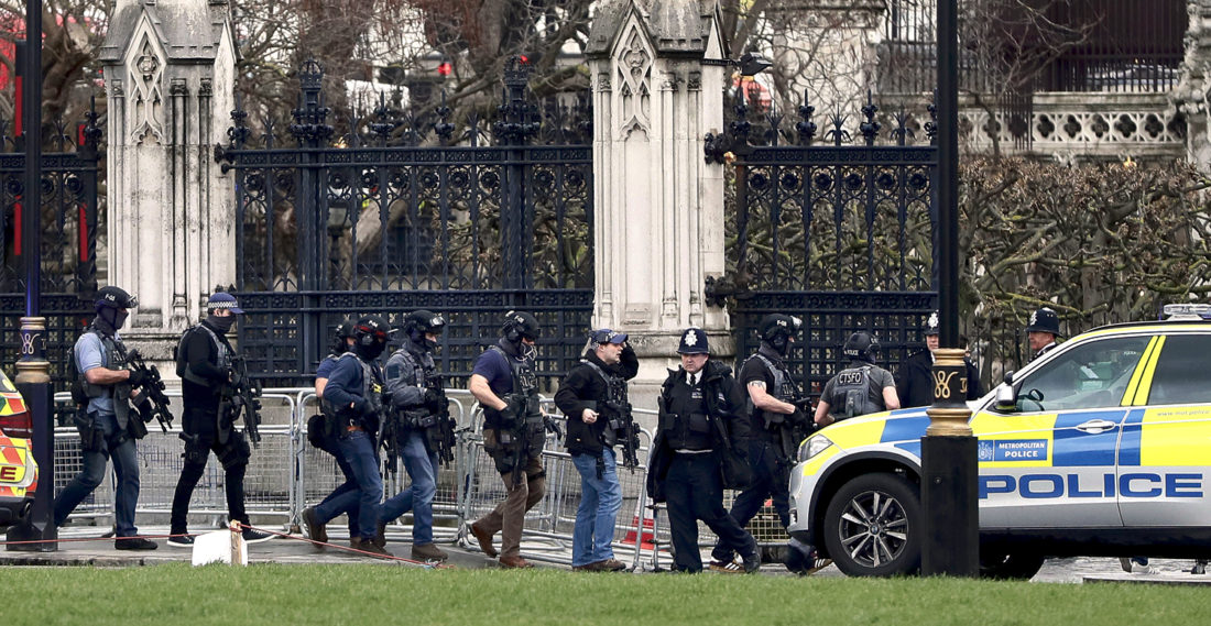 AP Armed police enter the grounds of the Houses of Parliament in London after a knife-wielding man went on a deadly rampage Wednesday, plowing a car into pedestrians on London's Westminster Bridge before stabbing a police officer to death inside the gates of Parliament. Five people were killed, including the man.