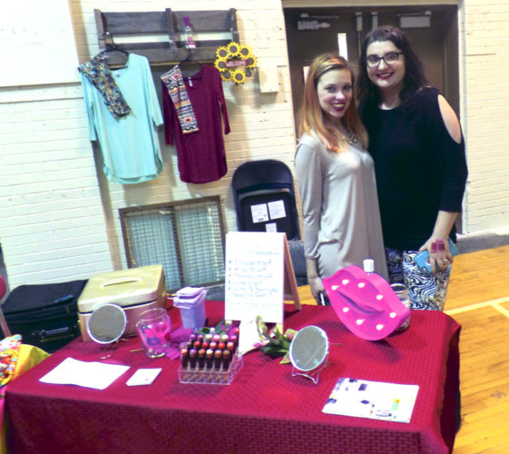 Emily D'Amico of Howland brought help from Erika Wilkinson of Akron to help with her display of  women's fashions and cosmetics Sunday at the Fowler Market.