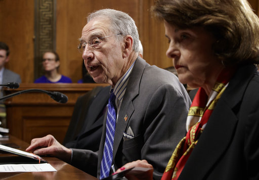 Senate Judiciary Committee Chairman Sen. Charles Grassley, R-Iowa, accompanied by the committee's ranking member Sen. Dianne Feinstein, D-Calif., speaks on Capitol Hill in Washington, Monday, March 27, 2017. Senate Democrats forced a one-week delay in a committee vote on Neil Gorsuch, President Donald Trump's Supreme Court nominee, who remains on track for confirmation with solid Republican backing. (AP Photo/J. Scott Applewhite)