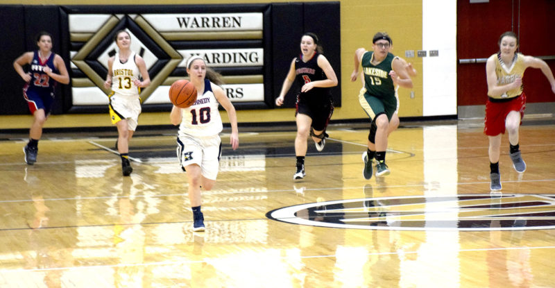 Tribune Chronicle / Joe Simon John F. Kennedy's Antonella LaMonica, center, dribbles up court as a host of players follow during Tuesday's Frank Bubba Classic in Warren.
