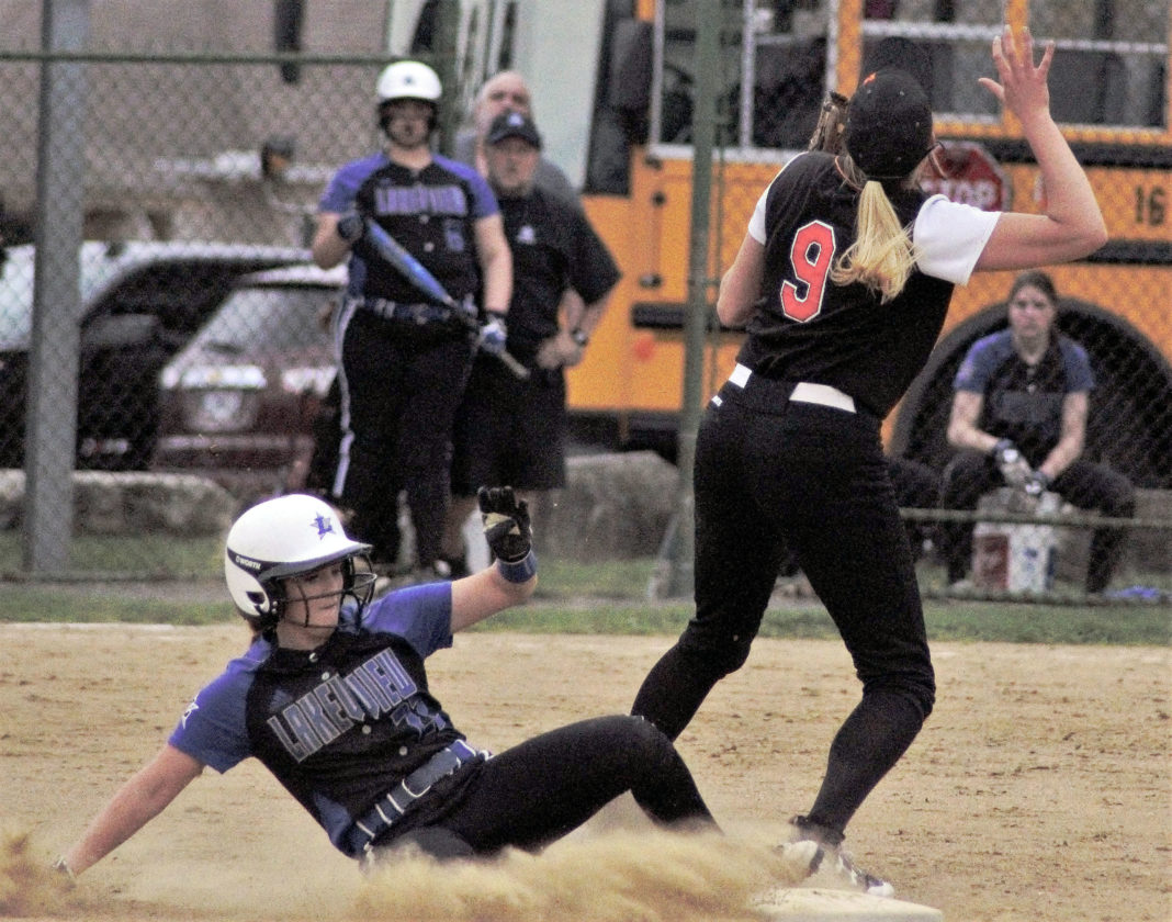 Tribune Chronicle / Bob Ettinger Cait Kelm of Lakeview slides into second as Howland shortstop Sara Price (9) waits for the ball to come down in Cortland on Wednesday.