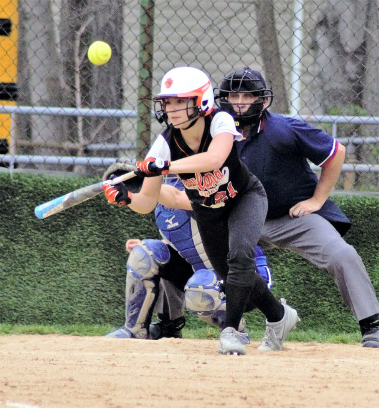 Marissa Jerina of Howland bunts the ball against Lakeview in Cortland on Wednesday.