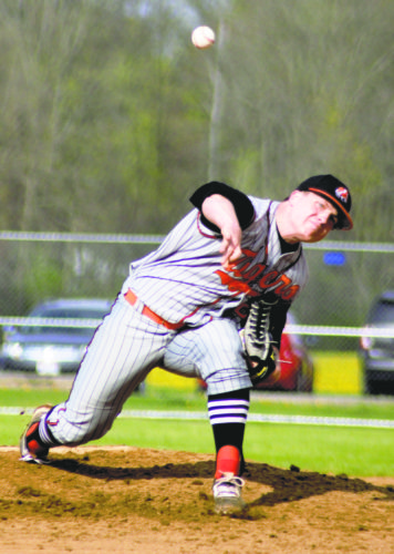 Tribune Chronicle / Bob Ettinger Howland right-hander Hayden Parker fires a pitch against Girard at Allan Segall Field on Friday evening. Parker helped the Tigers to a 6-3 win over the Indians.