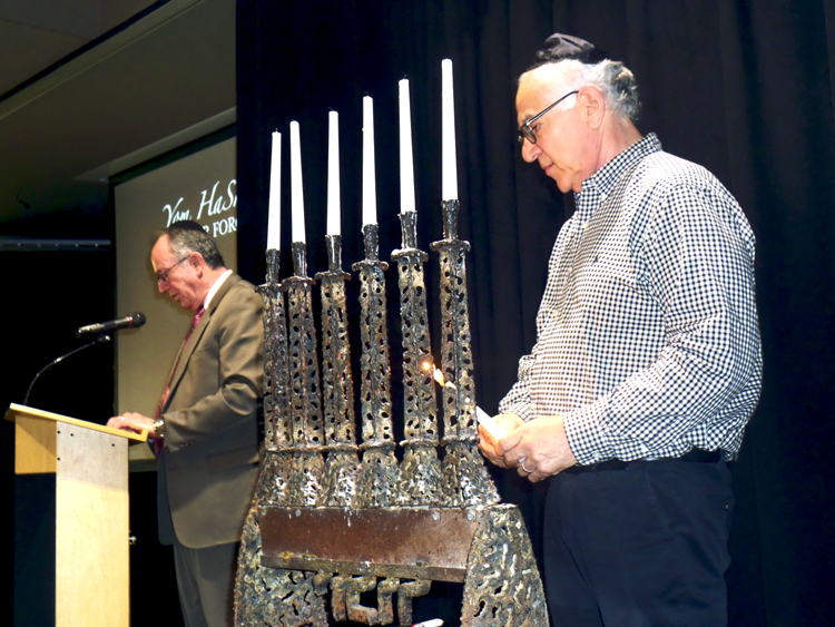 "Tribune Chronicle  / Guy Vogrin  Rabbis Joseph Schonberger, left, and Franklin Muller prepare for the candle lighting ceremony Sunday at the Jewish Community Center in Youngstown. The annual remembrance of the Holocaust had the theme ""The Power of Words in the Holocaust."""