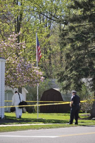 Members of the Ohio Bureau of Criminal Investigation and the Liberty Police Department investigate at 503 Churchill Road after a woman was found dead.