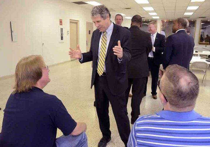Tribune Chronicle / R. Michael Semple U.S. Sen. Sherrod Brown, D-Ohio, center, talks with steelworkers Russ Williams of Warren, left, and James Walker, right, of Hartford, on Monday during a meeting about the impact of unfair trade practices and foreign steel dumping on local workers at the United Steel Workers Local 1375 Hall in Warren. Williams and Walker are steelworkers at Ohio Star Forge Co. and members of USW Local 2243.