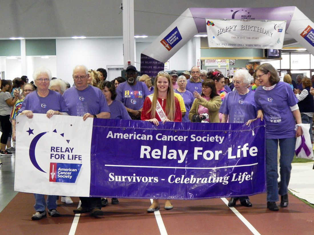 Tribune Chronicle / Bob Coupland  Cancer survivors walk the first lap at  the Niles Relay For Life event Friday at the Niles Wellness Center. The survivors holding the banner, from left, are Eleanor Antonell of Champion, a 25-year survivor; Terry Austin of Champion, a 17-year survivor; Miss Junior Niles 2016 Alaina Irwin; Dixie Harris of Champion, a 29-year survivor; and Patty Butler of Niles, a 23-year survivor. The 18-hour relay continues until 1 p.m. today.