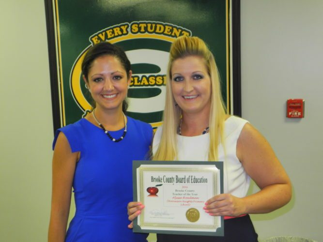 TEACHER OF THE YEAR — Alyssa Roadman, right, Brooke County's Teacher of the Year, is seen with Nicole Ennis, assistant superintendent of schools and former principal of Hooverson Heights Primary School, where Roadman teaches.  -- Warren Scott