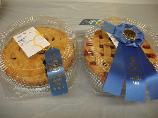 PRIZE-WINNING PIES — The Jefferson County Fair is the place to be when the baked goods are auctioned off from the domestic baking category in the 7th and 8th department. Both a cherry and peach pie went for $300 each, and a peanut butter pie went for $55. There also were apple and berry two-crust pies and custard and pecan. Prize-winning pies are not impossible to make — all it takes is a few directions and observe them until you know them by heart. -- Esther McCoy