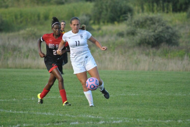 Matthew Peaslee ON THE PITCH — Madonna's Shannon Westfall keeps the ball away from Steubenville's Kandisi Anyabwile in Wednesday's match.