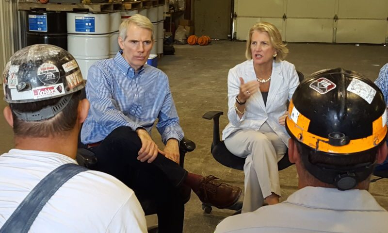SENATORS LISTEN —  U.S. Sen. Rob Portman, R-Ohio, was joined by Sen. Shelley Moore Capito, R-W.Va., during a stop at the Rosebud Bergholz Mine in Jefferson County Wednesday morning. They are listening to miners Josh Willis, left, and Jerry Murphy. -- Paul Giannamore