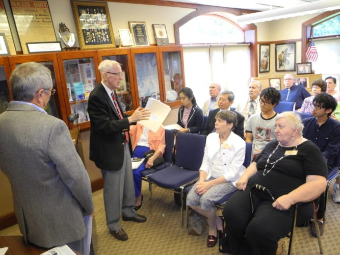INTERNATIONAL VISITORS — Ed Jackfert of Wellsburg related his experiences as a prisoner of war to Professor Kimio Yakushiji and several students from Ritsumeikan University in Kyoto, Japan, and others Friday during a visit to the National American Defenders of Bataan and Corregidor Museum, which Jackfert helped to launch in Wellsburg.  -- Warren Scott