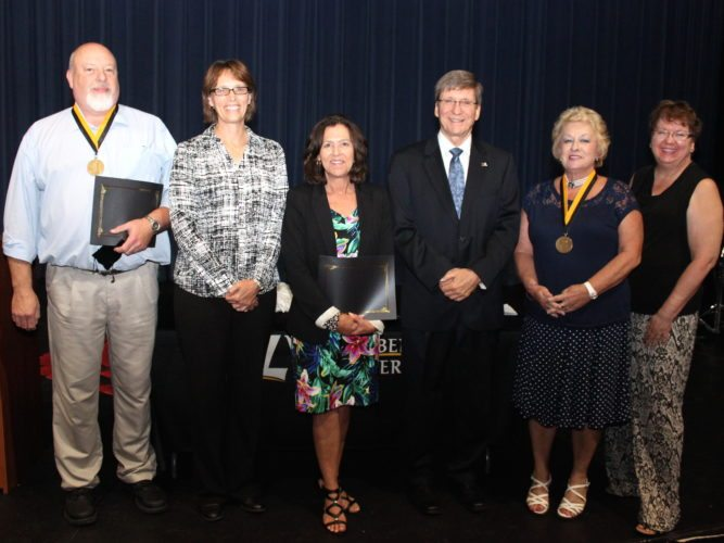 EMPLOYEES HONORED — West Liberty University honored several of its employees during Wednesday's opening convocation. From left, Roger Seeber, Rhonda Noble, Brenda King, President Stephen Greiner, Janet Kimble and Meta Lasch gather with their awards at the Opening Convocation. -- Contributed