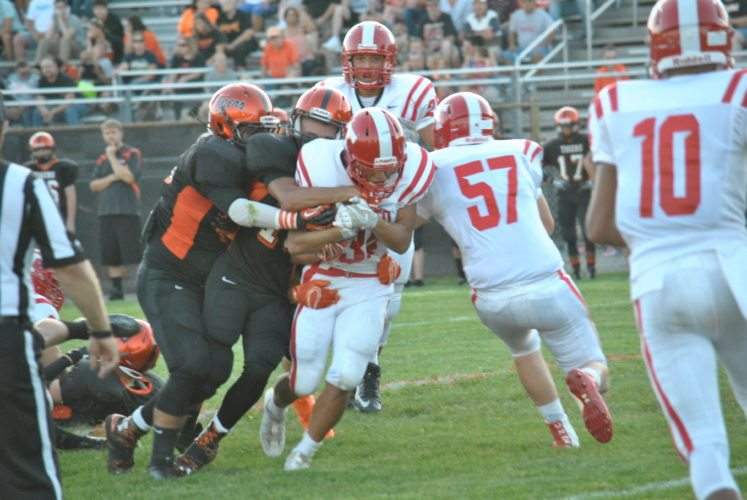 ONE DOWN — Toronto senior Max Tice runs for yardage during the first quarter of the Red Knights' 36-16 victory over rival Wellsville Friday. (Matthew Peaslee)