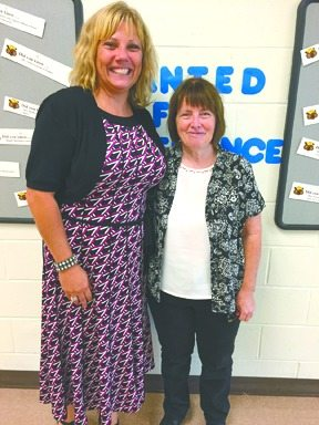 HONORED — First-grade teacher Nancy Holdsworth, right, with New Manchester Elementary School Principal Cindy Virtue on Friday. Holdsworth recently received the Presidential Award for Excellence in Mathematics and Science Teaching. -- Stephen Huba