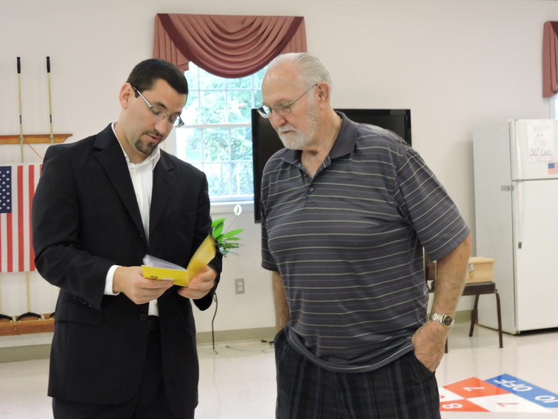 PREPARE AHEAD OF TIME — 46th District Rep. Jason Ortitay, R-South Fayette, left, speaks with Ron Maltony at the Greater Burgettstown Area Senior Center Monday before an American Red Cross-sponsored program on disaster preparedness. -- Summer Wallace-Minger