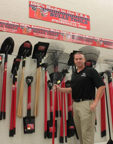 Mark Gracy, owner of Bully Tools, the Wintersville-based long-handled tool manufacturer, stands amid the lineup of company tools available for sale in the new Steubenville Rural King store. Bully has a presence in Rural King stores and is being offered additional space in the local store. — Contributed