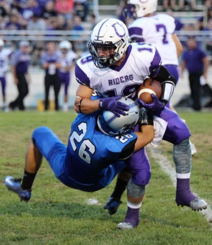 FINDING DAYLIGHT — Harrison Central's Coleman Dodds tackles Martins Ferry's Cory Bennett during the first half of Friday's 23-0 victory by the Huskies at Wagner Field. (Sandi Thompson)