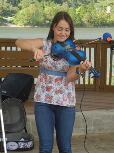 Kyler Kuzio was among the performers Saturday at the New Cumberland Fall Riverfest. The festival continues 11 a.m. to 5 p.m. today.  -- Mark J. Miller