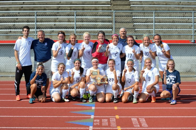 MADONNA CROWNED CHAMPS — Members of the Weirton Madonna girls soccer team pose for a photo following the Blue Dons 1-0 overtime victory over Wheeling Central in the OVAC girls 1A/3A championship on Saturday at Red Devil Stadium in St, Clairsville. (Mike Mathison)