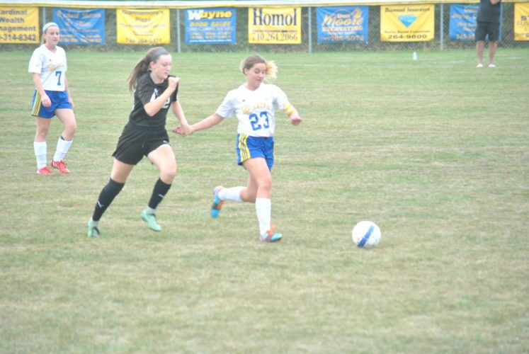 THRILL OF THE CHASE — Edison's Lauren Ferralli and Catholic Central's Naomi Spencer run after a loose ball in the first half of Wednesday's game at the Tony Recinella Soccer Field. The Crusaders beat the Wildcats, 3-1. (Matthew Peaslee)
