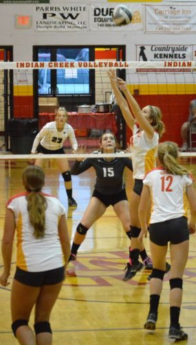 TO THE OUTSIDE — Indian Creek senior Savannah Shanley sets a pass while Edison's Kayla Huff (15) and Skylar Fankhauser look on during Thursday's four-set win by the Wildcats. Also looking on are Redskins teammate Sarah Mazzaferro (12) and Sydney Karas. (Mike Mathison)