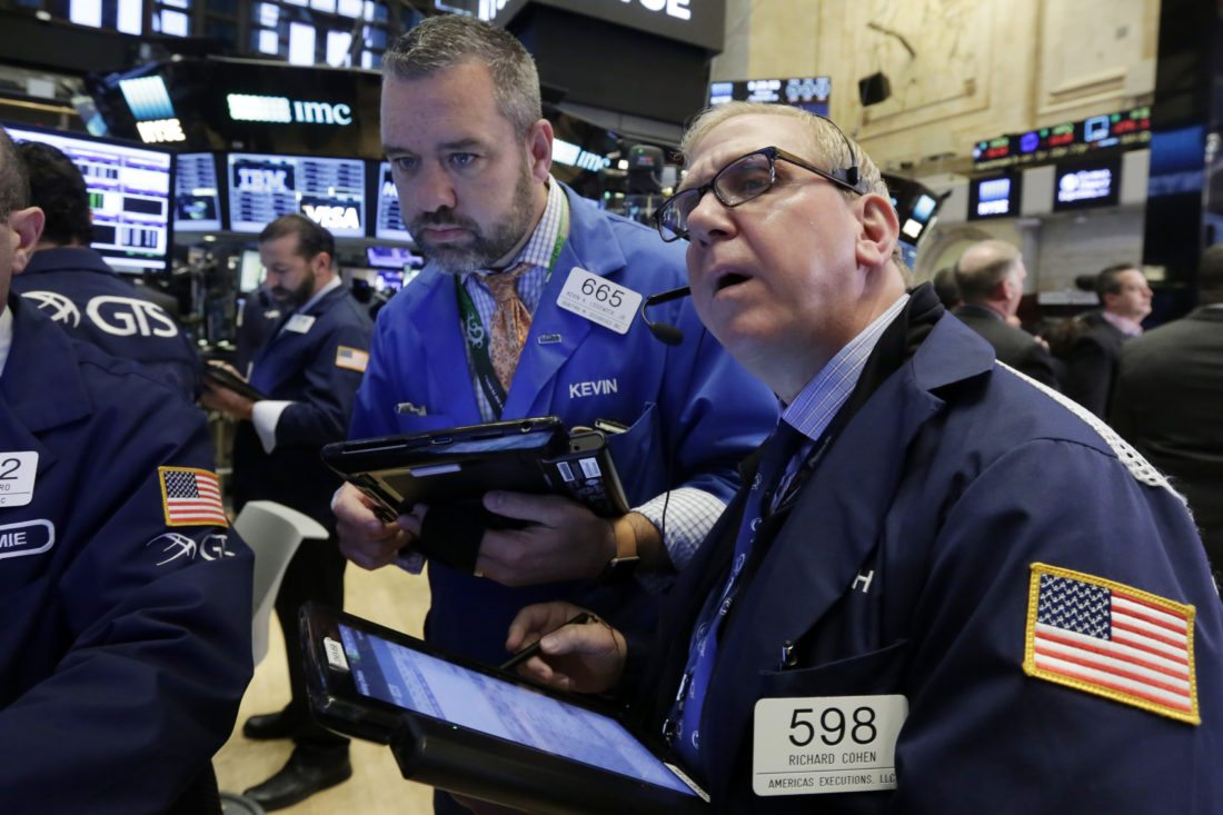 FILE - In this Monday, Sept. 26, 2016, file photo, traders Kevin Lodewick, left, and Richard Cohen work on the floor of the New York Stock Exchange. U.S. stocks are bouncing back early Friday, Sept. 30, 2016, after a steep loss late the previous day. (AP Photo/Richard Drew, File)