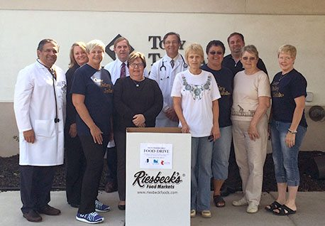 Among those working on a food drive to help the Cancer Dietary Initiative are, front, from left, Chris Hyland, Patti D'Aurora, Lois Spence, June Crago, Marge Landy Krohn and Tammy Smedley; and back, Dr. Pervaiz Rahman, Crystal Pasco of Valley Hospice, Dr. John Hyland, Dr. Dennis Meisner and Chris Orris of Valley Hospice. — Contributed
