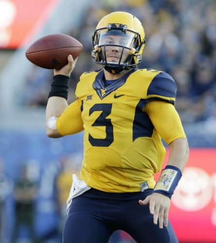 FILE - In this Oct. 1, 2016, file photo, West Virginia quarterback Skyler Howard passes during an NCAA college football game against Kansas State in Morgantown, W.Va. West Virginia plays TCU this week. Howard (eighth nationally with 357 total yards per game) is a Fort Worth native. (AP Photo/Raymond Thompson, File)