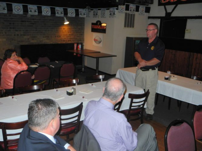 DISASTERS DISCUSSED — Bob Fowler, Brooke County director of emergency management, discussed his part in responding to flooding in Nicholas County, W.Va. and in Follansbee at a business after hours held in honor of local first responders by the Wellsburg Chamber of Commerce Thursday at The Station Grille. Mullenbach Funeral Home and Wellsburg Tire and Collision sponsored the event.	 -- Warren Scott