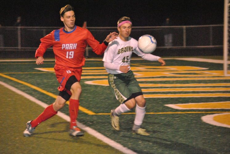 CHASING IT DOWN — Trevor Hamm, left, of Wheeling Park and Garret Bernardini of Brooke go after a loose ball in the first half of Saturday's game at Brooke High School. The Patriots beat the Bruins, 2-1, to claim the Class AAA Region I, Section I championship. (Matthew Peaslee)