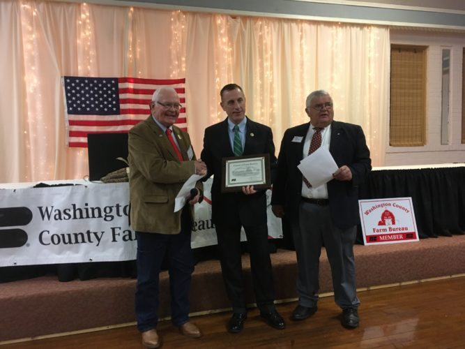 AWARD PRESENTED — U.S. Rep. Tim Murphy, R-Upper St. Clair, center, was recognized as a Friend of the Pennsylvania Farm Bureau recently. On hand to present his award was, from left, Washington County Farm Bureau Vice President John Scott and presenter Doug Bentrem. -- Contributed