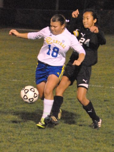Matthew Peaslee SHIELDING — Edison's Melissa Tran attempts to steal the ball away from Catholic Central's Kristina McNamara in the second half Wednesday.