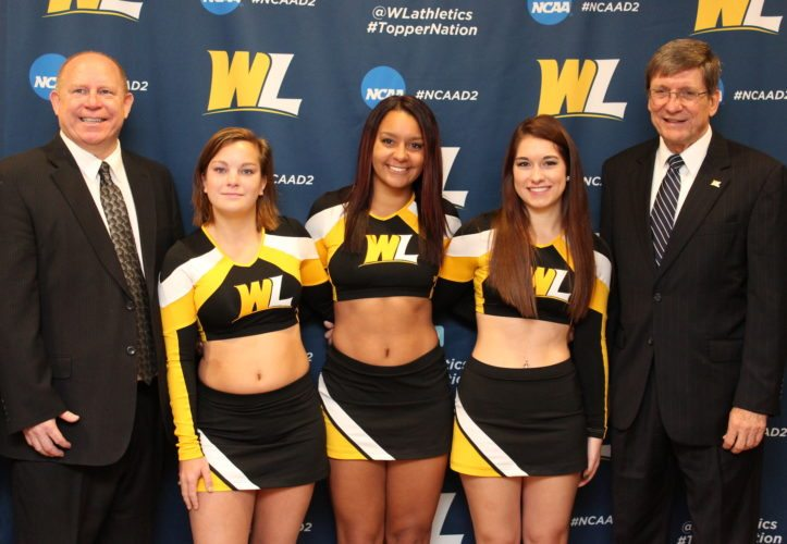 Contributed SPORT ADDED — Co-Interim Athletic Director Lynn Ullom, left, and President Stephen Greiner join cheerleaders, from left, Holly Davis, Kayce Neely and Alyssa Baker, at the podium as they announce the addition of the intercollegiate sport of acrobats and tumbling to Hilltopper athletics.